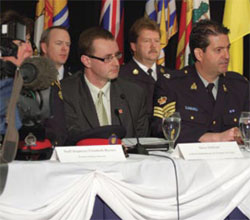 Ombudsman for Victims of Crime, Steve Sullivan, shown here beside Sergeant Dave Fox at the national news conference for Project Salvo
