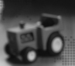 A blurry photo of a toy truck