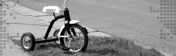 Photo of a tricycle on a sidewalk
