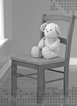 Photo of a teddy bear sitting in a chair, looking out a window