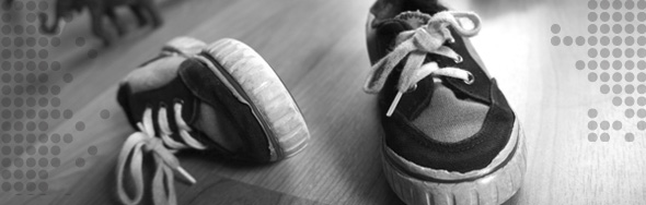 Photo of child's shoes on a floor